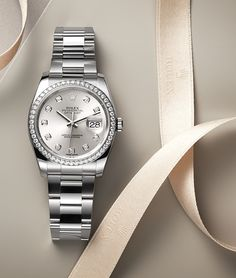 The diamond-set bezel and hour markers on the dial enhance the allure of this white Rolesor version of the Rolex Datejust 36.