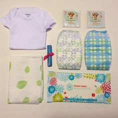 Whoopsie Kit includes; 1 disposable changing pad, 2 garbage bags, 2 hand sanitizing wipes, 1 package travel baby wipes, 2 diapers and 1 onesie.