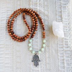 I would like these Bayong Wood & Crystal Mala Beads