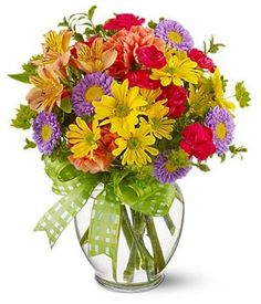 Yellow colored flower spray chrysanthemums purple Matsumoto asters hot pink small carnations orange carnations and alstroemeria. Send it now for only $65. For more please visit http://www.flowersnext.com/florist/category/weddings.asp