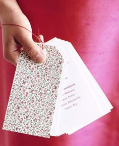 Luggage tag wedding ceremony programme - floral and fun.