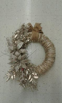 Gorgeous rustic wreath made just for you! The wreath shown is a mock up of the one you will receive. A glittered 3D twig wreath is decorated with stunning taupe poinsettias, glittered taupe/platinum/gold fern fronds, rich matte gold eucalyptus sprigs, matte platinum bayberry