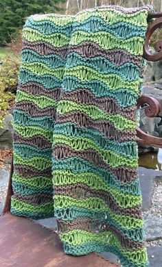 Free knitting pattern for Breezy Baby Blanket - This easy pattern by Pickles features a light version of the drop stitch sea foam pattern, which makes it airy, stretchy and comfortable in warm weather.