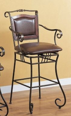 "29""h Scroll Motif Bar Stool In Metal Finish by Coaster Home Furnishings. $148.34. kitchen bar stool; wrought iron stool; brown barstool; casual bar stool; bar stool wrought iron. 29""H Scroll motif bar stool in metal finish featuring beautiful crafted details. Matching leather padded seat and back for your extra comfort. This furniture will definitely command some attention whenever someone see it. Lowest factory direct price guarantee.. Save 67%!"