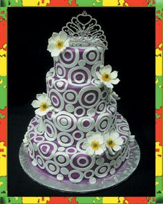 Purple circles and flowers on wedding cake (probably quince for this one, actually). Eccentric International Chefs, Santee, CA