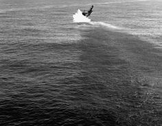 Lieutenant (jg) Oliver Droege's F4U-4 Corsair fighter crashing into the water after suffering an engine failure on takeoff off Korea 19 May 1951.