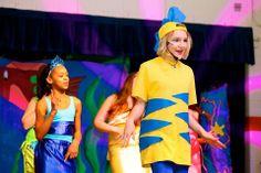 Flounder- T-shirt with blue felt stripes and backwards yellow cap with blue felt fin.