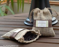 Wedding Favors - I like the coffee beans in Mason Jars idea. (Not fattening, and most enjoy.  Possibly cheaper than wine.)
