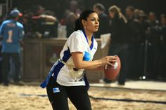 Pin for Later: See the Star-Studded Super Bowls From Years Past!  Jordin Sparks prepared to throw the football during the sixth annual Celebrity Beach Bowl Game in 2012.