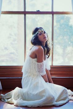 Beautiful white off the shoulder dress with lace detail. Lovely silver head piece. My perfect bohemian style.