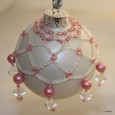 I've been busy making beaded netting ornaments For this one I used this pattern BUT depending on you beads you may have to adjust on the l. Wire Ornaments, Glitter Ornaments, Handmade Ornaments, Beaded Christmas Decorations, Unique Christmas Ornaments, Christmas Crafts, Christmas Stuff, Beaded Ornament Covers, Beads And Wire