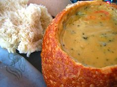 Creamy broccoli and cheese soup in a sour dough bread bowl
