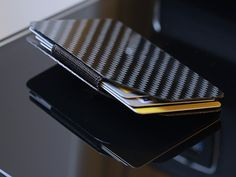 The Tronic card wallet: The Thin Flexible CarbonFibre wallet by Peter Wright, via Kickstarter.