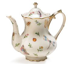 "#burtonandburton Handwash only/FDA approved.Morning Meadows Porcelain teapot with botanical design of butterflies, ladybugs, bees and flowers.  Includes white satin lined gift box. 7 3/4""H X 2 1/2""Opening. Holds 32 oz.Set of 2.Individually gift boxed."