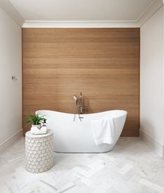White Oak Paneled Wall Accent Wall The wood accents and neutral marble tile keep this room bright, clean, and tranquil White Oak Paneled Wall Accent Wall The wood accents and neutral marble tile keep this room bright, clean, and tranquil White Oak Paneled Wall Accent Wall The wood accents and neutral marble tile keep this room bright, clean, and tranquil #WhiteOak #PaneledWall #BathroomAccentWall #marbletile #Bathroom