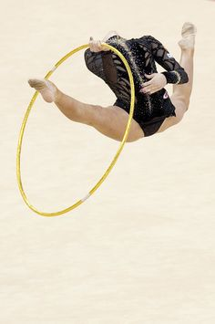 ( AFP/Getty Images / January 18, 2012 ) Daria Kondakova of Russia performs with the hoop during the final of the Rhythmic Gymnastics London 2012 Olympic qualifier, a part of the London Prepares series of test events, at the North Greenwich Arena in London.