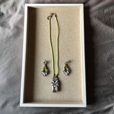 NORDSTROM jeweled necklace/earring set Love the fluorescent accents and the contrasting baby blue with this set. The jewels are very sparkly as well. This set was only worn once and is in EXCELLENT condition. Nordstrom Jewelry Necklaces