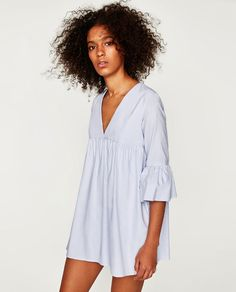 Image 1 of JUMPSUIT DRESS WITH RUFFLED SLEEVES from Zara