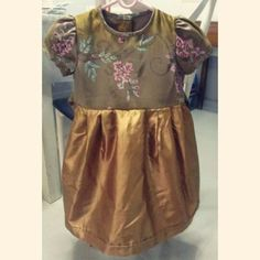 An amazing silk gold dress