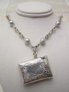 very special engraved sterling silver vesta/match safe necklace designed by Tamara Berg.