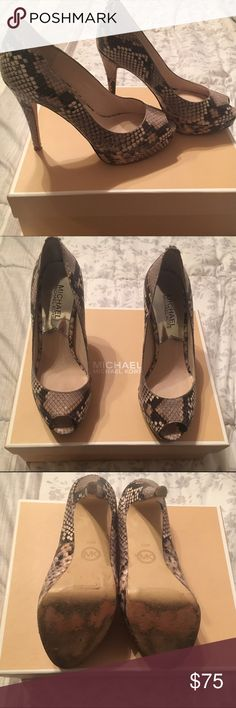 """MICHAEL Michael Kors York Python Platform Pump Sexy platform peep-toe pumps! Only worn a couple of times and in fine condition! The only noticeable scuffs are on the bottom of these shoes. 4"""" heel, 1"""" platform. Comes with original box. Michael Kors Shoes Platforms"""