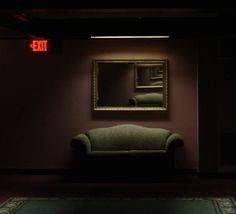 I want an exit sign in my house... and this couch and mirror and wall colour ;)