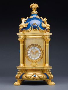 Patek Philippe 'The Royal Blue - Masterpeice Dome' clock, 1980. Baroque style; yellow gold, silver, diamond, lapis lazuli and enamel.