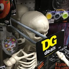 Here an interesting Dollar-General-Deals Scan-Hook Callout promotes Halloween Merchandise. Forward-looking this is more a Faceout Talker than Promo Flag. Retail Fixtures, Store Fixtures, Posable Skeleton, Dollar General, Skulls, Hooks, Fish, Halloween, Haken