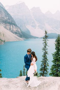 Boho Bride And Groom Embrace Overlooking Moraine Lake During Their Banff Alberta Wedding