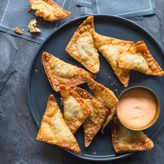 Crispy Shrimp Won Tons with Sriracha Mayo | Reader Jean Oh, of Cerritos, California, sent in this family recipe. We'd like to say that they're just as good baked, but honestly, they really are best fried. The Sriracha mayo puts it over the top. Won ton wrappers vary in size, so if you use smaller wrappers, you'll get more won tons.