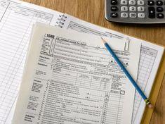 US tax forms - Jeffrey Hamilton/Digital Vision/Getty Images