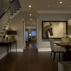 Dark floors, gray walls. LOVE THE PAINTING ON THE WALL!