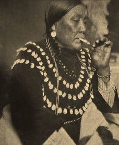 Rosa Lone Woman-Heavy Breast (the daughter of Calf Robe and First Strike, and the wife of Owen Heavy Breast) smoking a cigarette - Blackfeet (Pikuni) - circa 1925 Native American Artifacts, Native American Tribes, Native American History, American Indian Art, American Pride, Sioux, Cherokee, Navajo, Blackfoot Indian