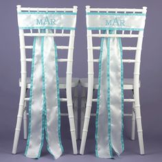 """Custom Chair Sashes  White, satin chair sashes with 5/8"""" grosgrain ribbon and custom embroidery fit a 16"""" chair back and are sold in a set of two. Sashes may be personalized with up to 17 characters including spaces with your names or single or three letter monogram in the embroidery lettering style and ribbon color of your choice."""