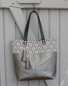 Dark gray faux leather tote bag fabric gray graphic upholstery, tote bag,  tote bag, leather shopping bag handles, and tassels. 4d3b2b5a6bf