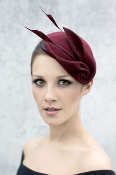 Louisa is a hand formed wool felt cocktail hat with feather spears. The hat can be made in other colours, the feathers are also available in similar colours to the felt shades. * Made to Order. * Please leave your colour selection when ordering. * Attaches with millinery elastic.