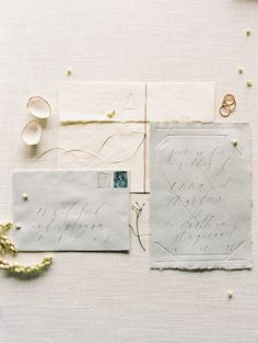 A beautiful invitation suite with calligraphy, handmade paper, and blind embossing.