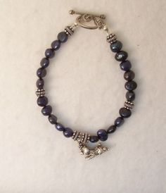 toy poodle and pearl bracelet