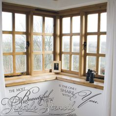 A beautiful vinyl wall sticker quote that reads: The most beautiful view is the one I share with you. Romantic wall lettering that looks great near a master bedroom window.