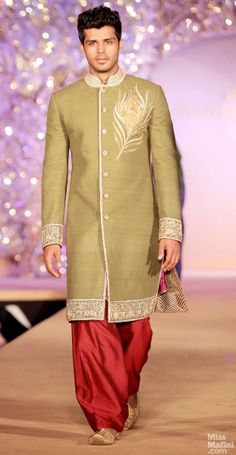 Olive and red suit. Abu Jani and Sandeep Khosla presents The Golden Peacock Collection.