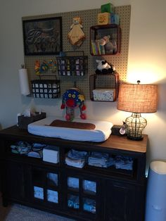 Used a media cabinet for a changing table - works great! And my husband built the pegboard frame and galvanized pipe paper towel holder.