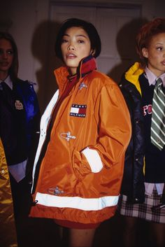 A look from Tommy Hilfiger Fall 1997 (Photo by David Turner) the girl in the back with the plaid skirt & tie. super cute!