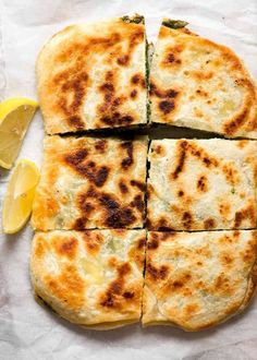 Overhead photo of Spinach and Feta Gozleme cut into 6 pieces served with lemon wedges on the side Turkish Recipes, Greek Recipes, Light Recipes, Romanian Recipes, Scottish Recipes, Gozleme Recipe, Vegetarian Recipes, Cooking Recipes, Healthy Recipes