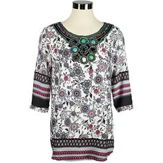 This lovely top is hand made from 100% cotton - sure to keep you cool and comfortable in all weather. The floral batiked pattern is alive with colour that is ac