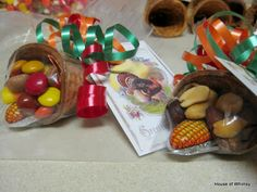 Little cornucopia: could be used for party treats, teacher treats, seating place cards. could fill with fall colored candies, Runts, nuts, cereal. Might want to add small amount of icing to hold candy. Might dip top of cone in melted chocolate and sprinkles and use chocolate to hold candy. Might adapt for Halloween or other holidays.