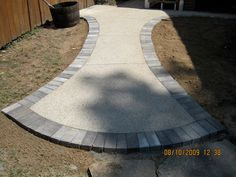 Exposed Aggregate & Pavers - Concrete / cement walkway with grey brick outline. Ideas for our front walkway and stairs
