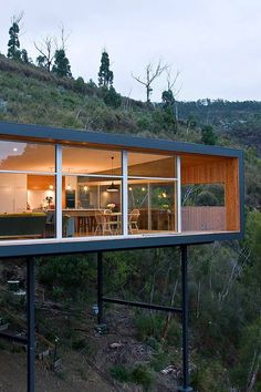 """Container House - Wood house with single level """"built at the height"""" on a metal frame - Who Else Wants Simple Step-By-Step Plans To Design And Build A Container Home From Scratch? House On A Hill, House In The Woods, Residential Architecture, Interior Architecture, Contemporary Architecture, Vintage Architecture, Chinese Architecture, Futuristic Architecture, Amazing Architecture"""