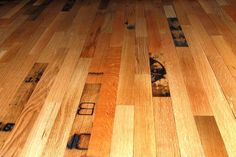 Reclaimed whiskey barrel flooring.  Very cool.--maybe for C's scotch and cigar room...LML