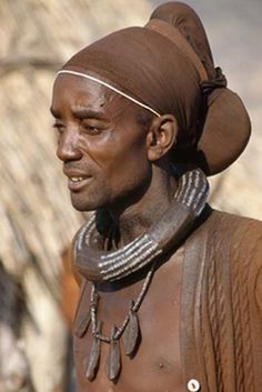 A man from the Himba tribe. Angola/Namibia , Africa .