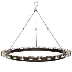 Warm candlelight flickers against smooth metal, making this chandelier a halo of simple contrasts. A metal circular structure is outlined by detachable glass votives and supported by three durable chains. Candles not included.